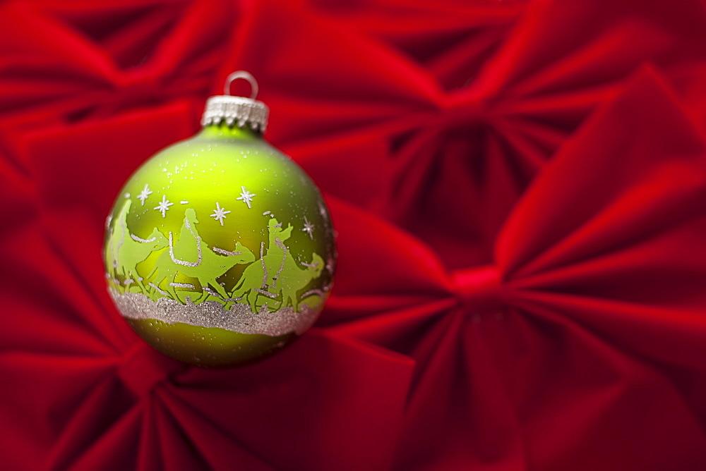 Studio Shot of red velvet bows with green Christmas ornament