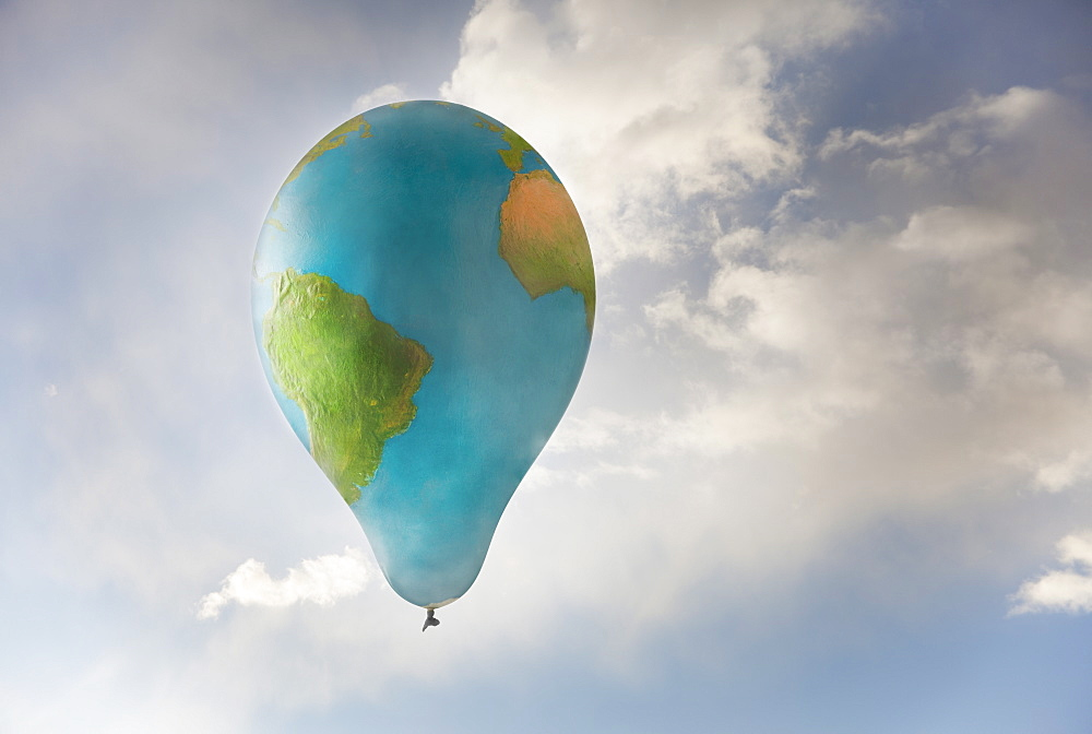 Earth-shaped balloon flying