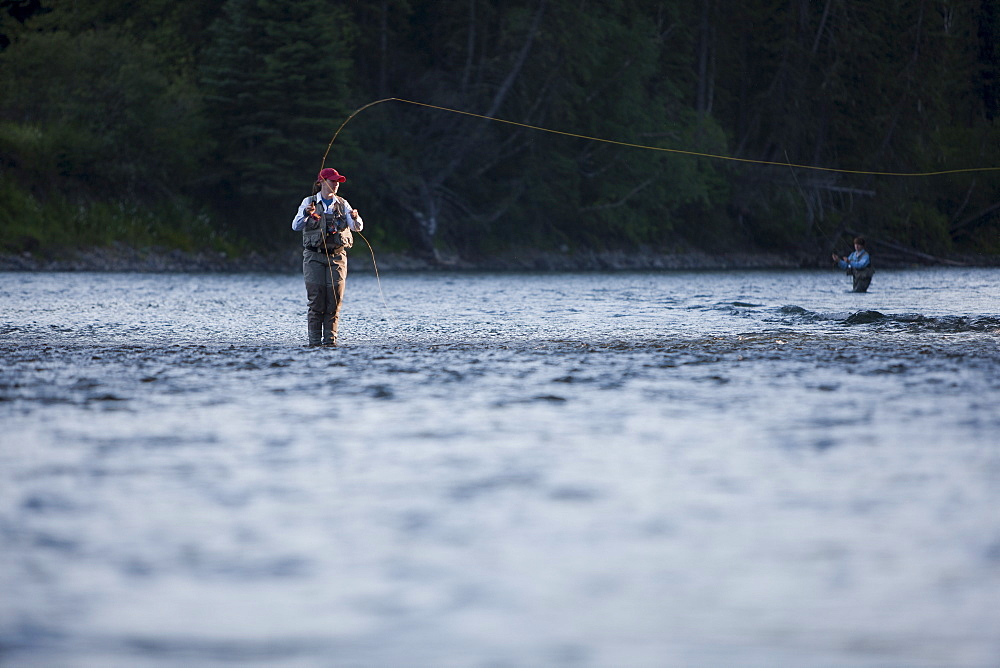 Canada, British Columbia, Fernie, Woman fly fishing in river