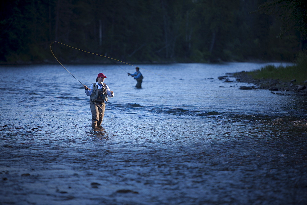 Canada, British Columbia, Fernie, Women fly fishing in river