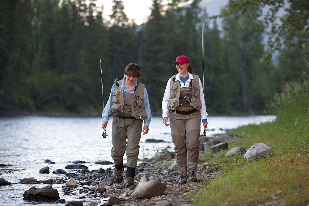 Canada, British Columbia, Fernie, daughter and mother fly fishing