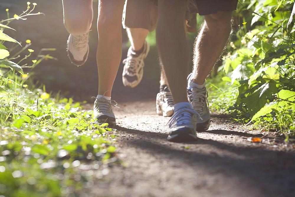 Canada, British Columbia, Fernie, Foot of three jogging people