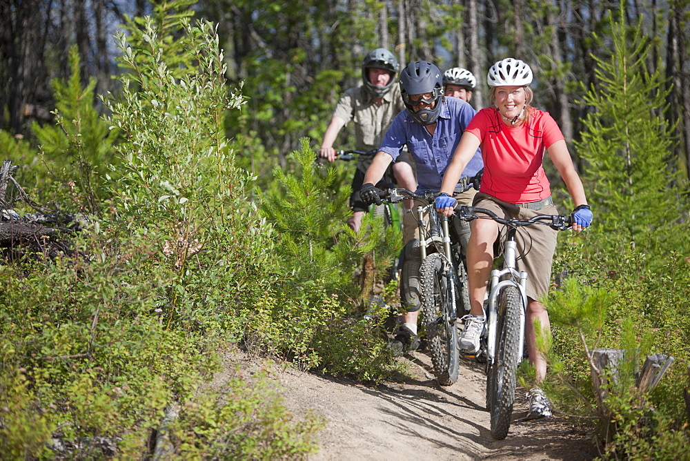 Canada, British Columbia, Fernie, Group of five people enjoying mountain biking