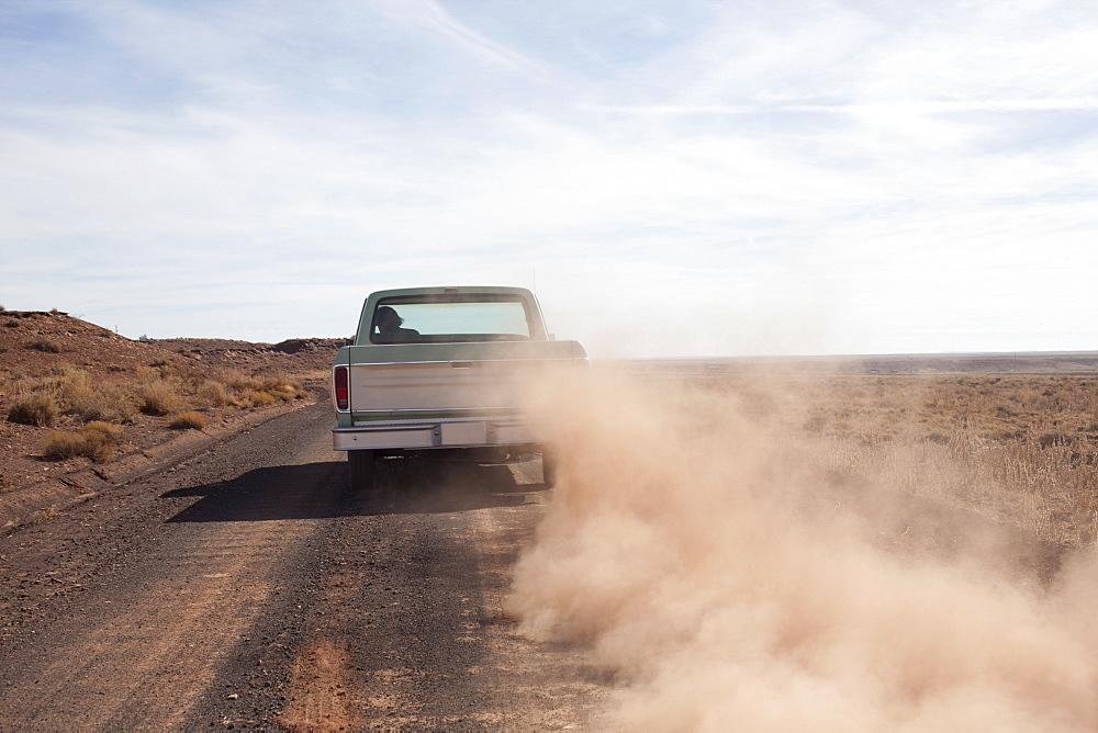 USA, Arizona, Winslow, Pick-up truck driving