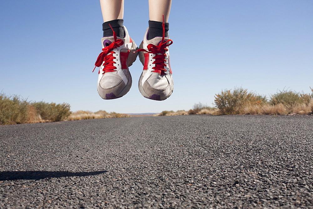 USA, Arizona, Winslow, Human feet in sport shoes jumping