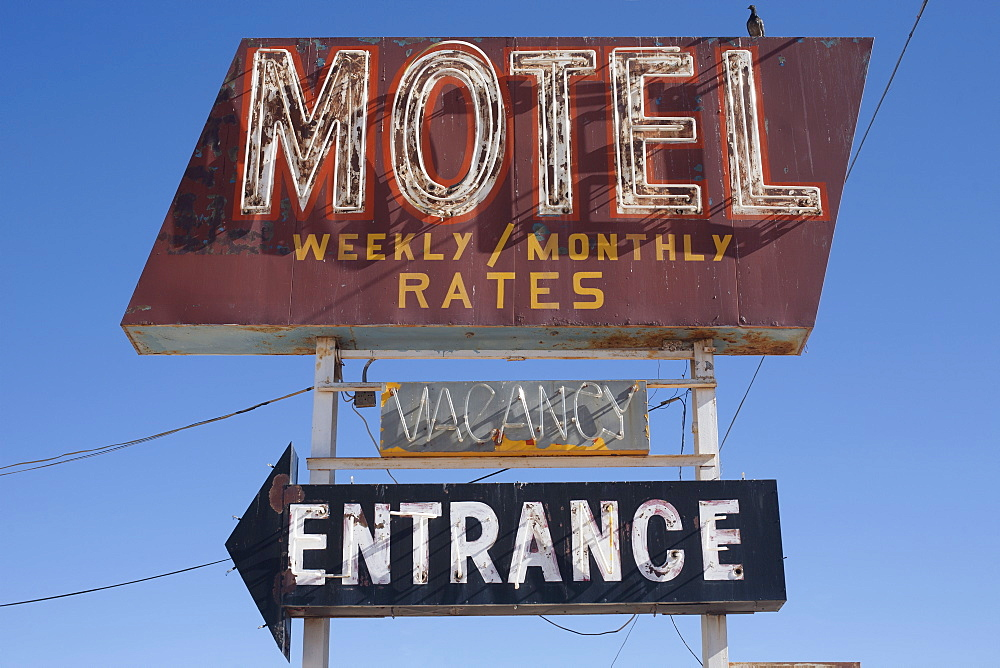 USA, Arizona, Winslow, Old-fashioned motel sign against blue sky