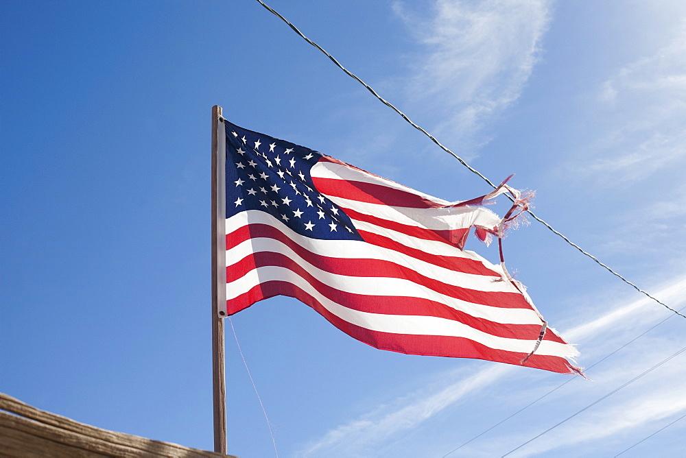USA, Arizona, Winslow, American flag on wind