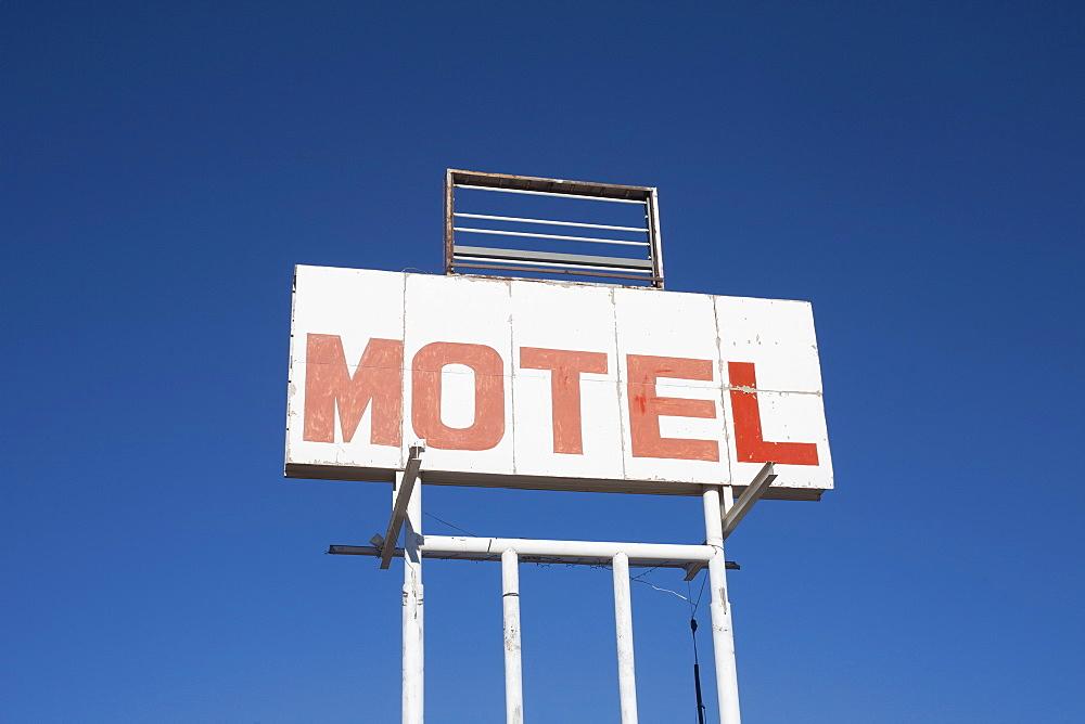 USA, Arizona, Holbrook, Motel sign against blue sky