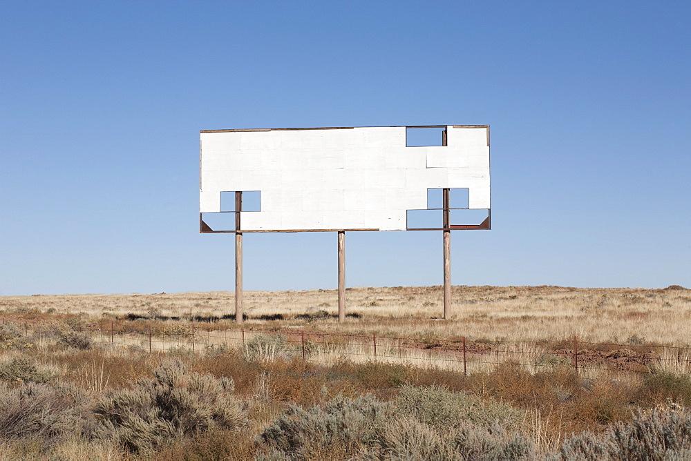 USA, Arizona, Winslow, Blank billboard against blue sky