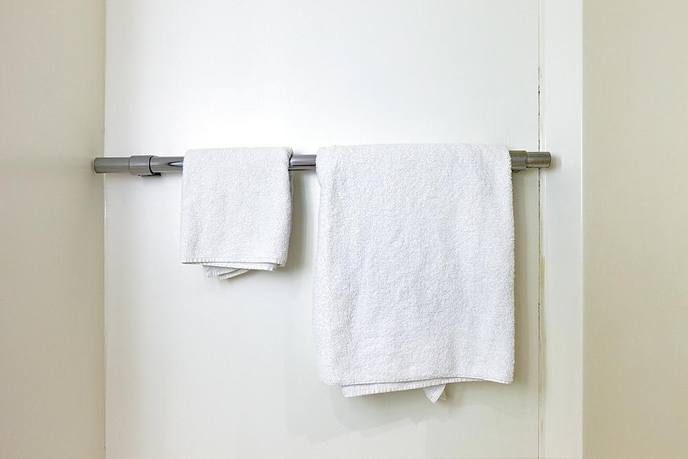 Towels hanging on rail in bathroom