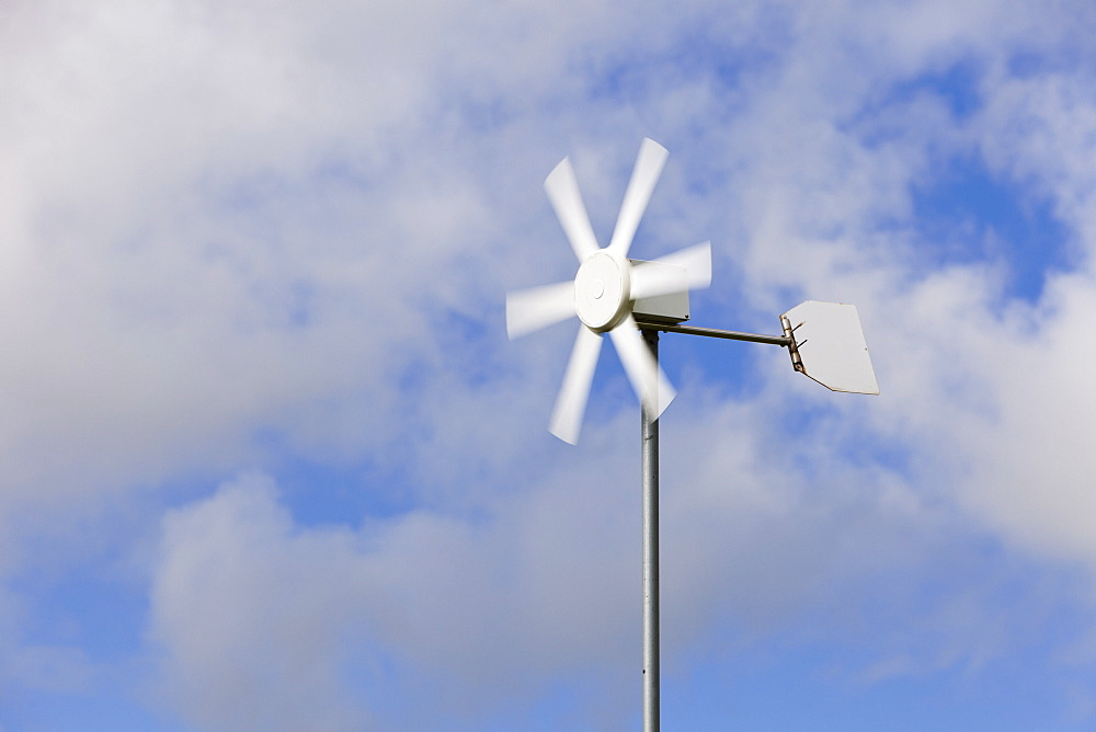 Old wind turbine against cloudy sky