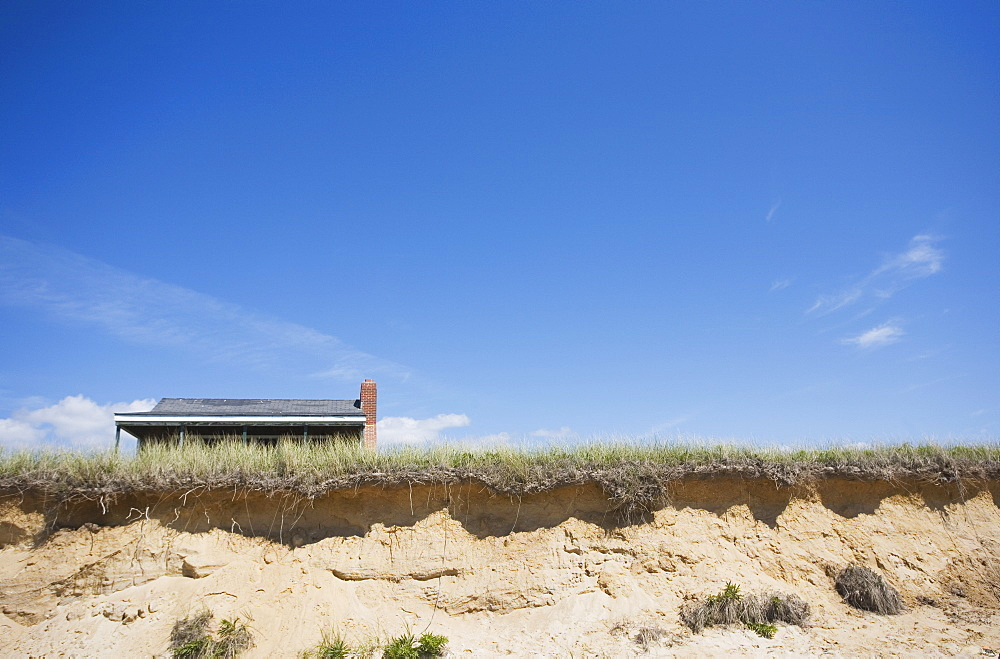 Dunes and roof in the background