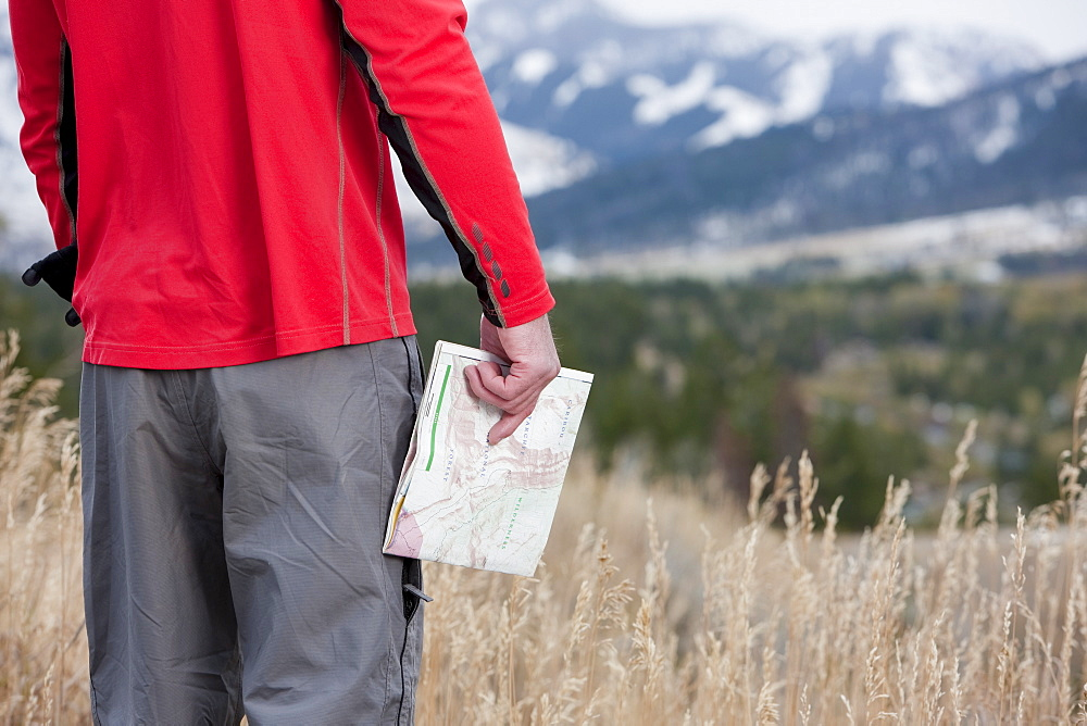 Hiker holding a map