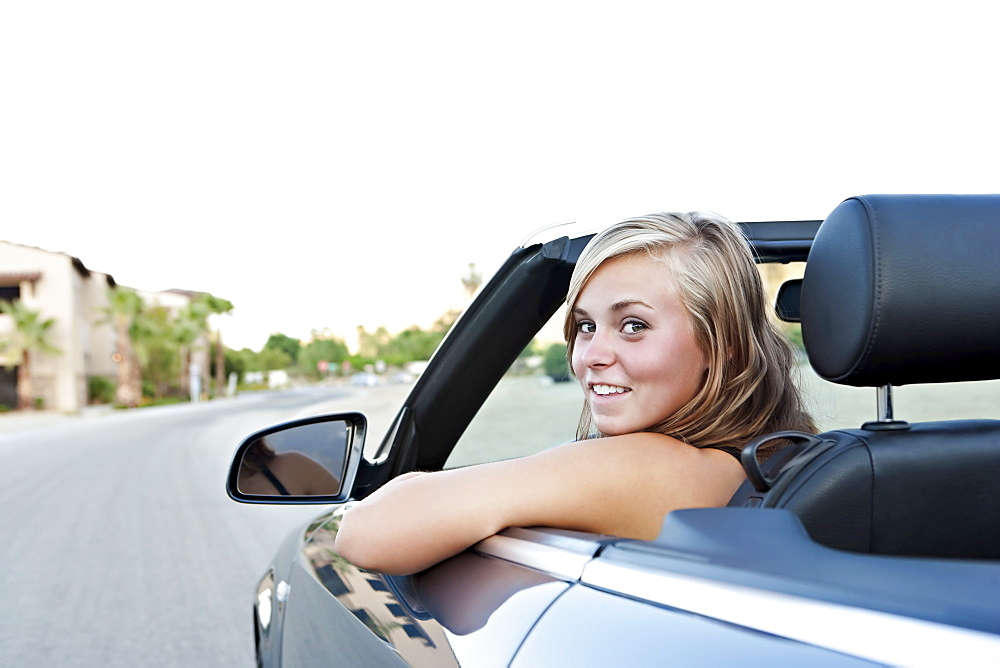 Woman driving convertible