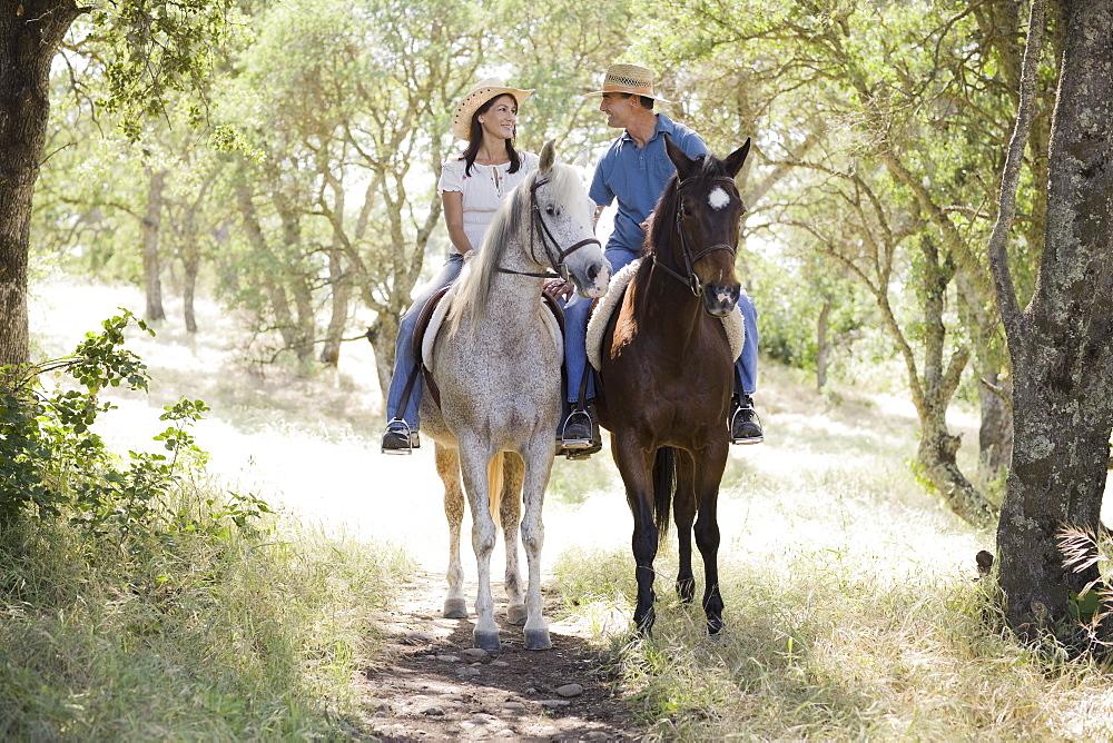 A couple riding horses