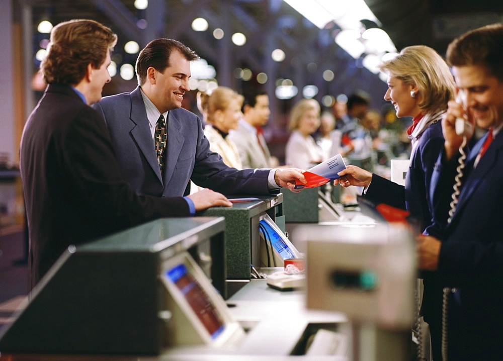 Businessman buying ticket at the airport