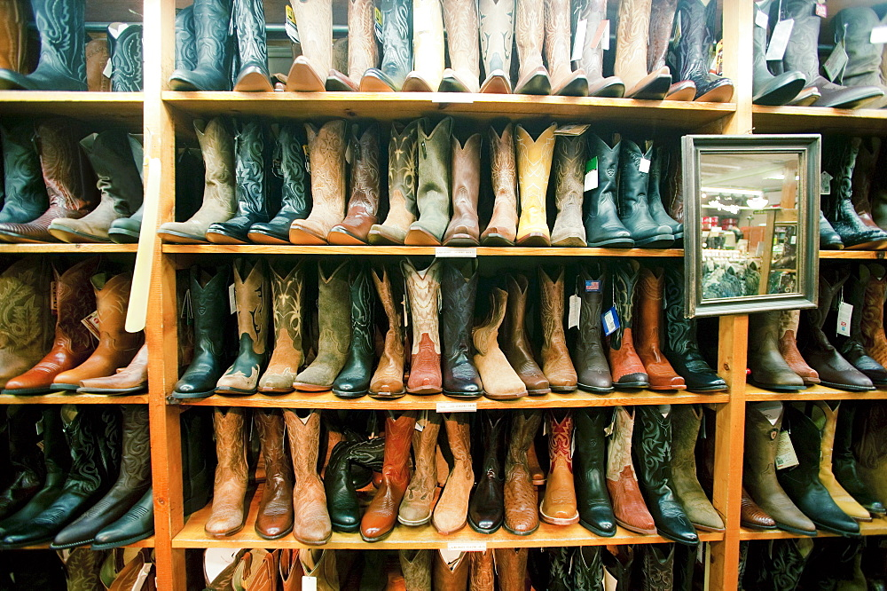 Boot in row on shelves in shop, Aspen, Colorado, USA