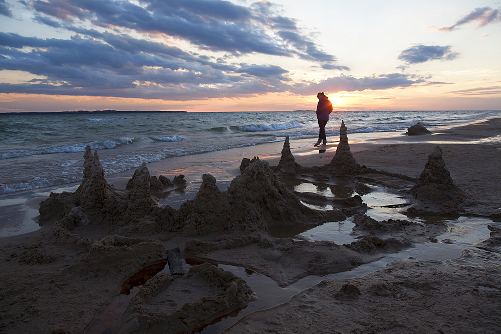 Beaver Island, Lonely person walking on beach during sunset, Beaver Island, Michigan, USA