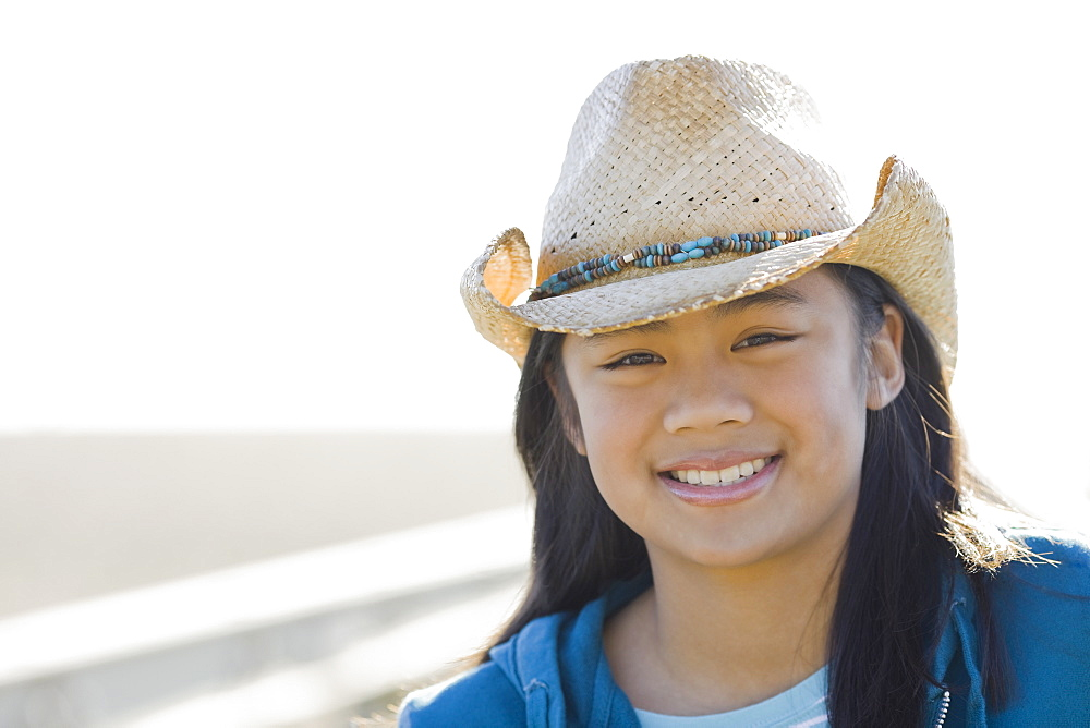 Portrait of teenage girl wearing cowboy hat