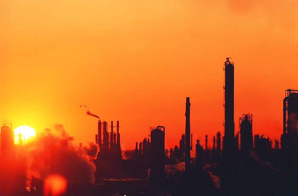 Sun setting on oil refinery in Baytown, Texas