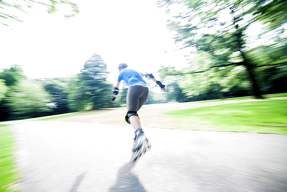 Woman roller skating in park, Netherlands