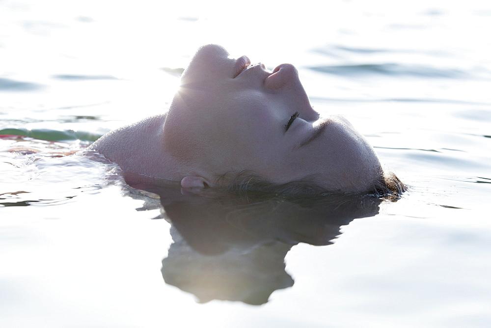 Woman relaxing in lake