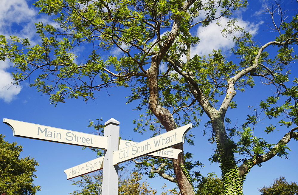 Low angle view of direction signs, Nantucket, Massachusetts