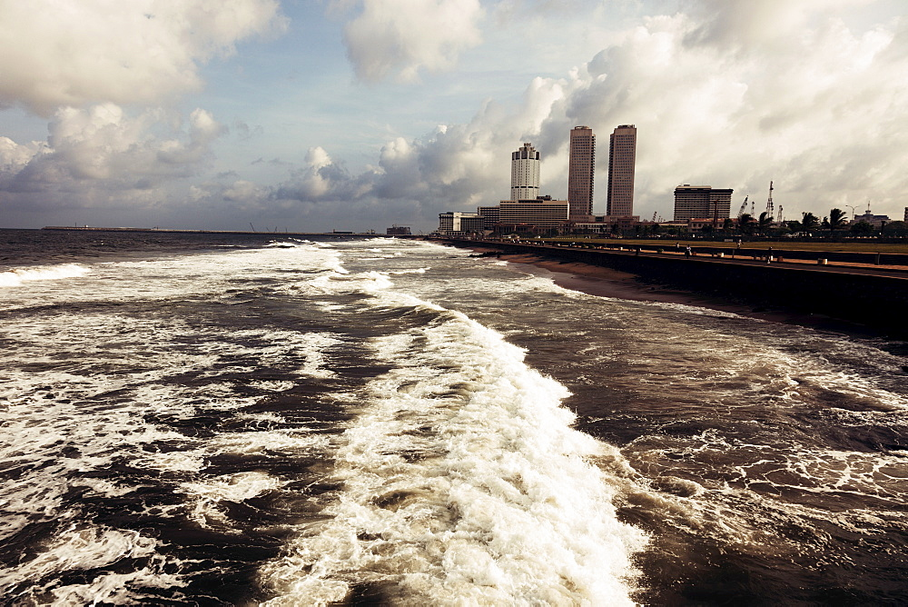 Waves of Indian Ocean and city skyline, Sri Lanka, Colombo