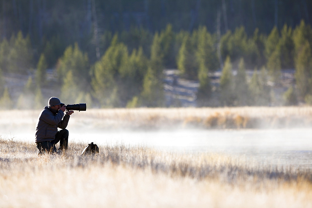 Man photographing nature, USA, Montana
