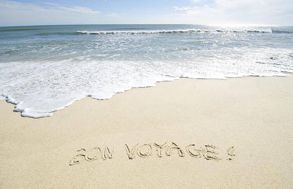 Bon Voyage' note on sand