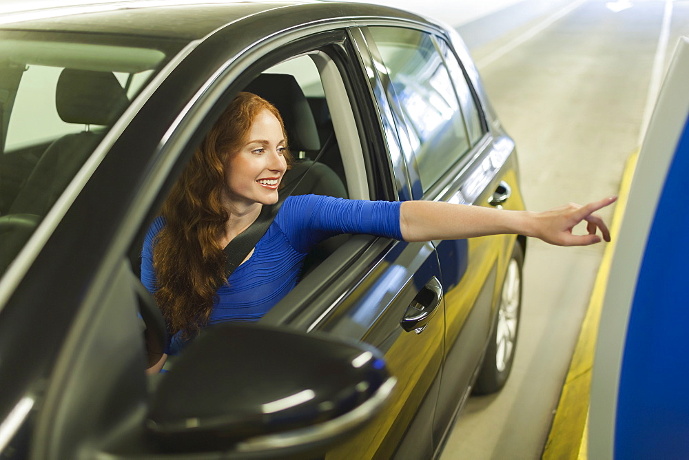 Young woman parking car