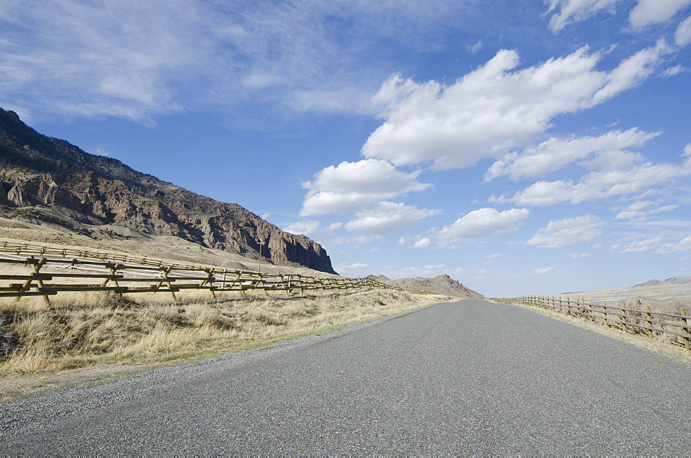 Road going through arid landscape, Wyoming