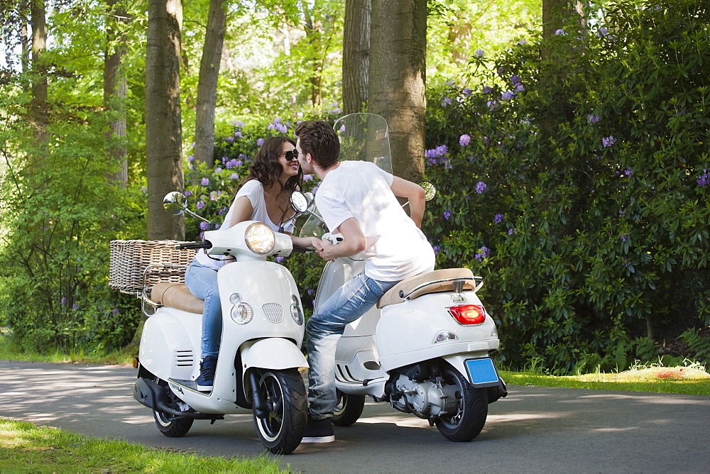 Couple on scooters, Netherlands, Oisterwijk