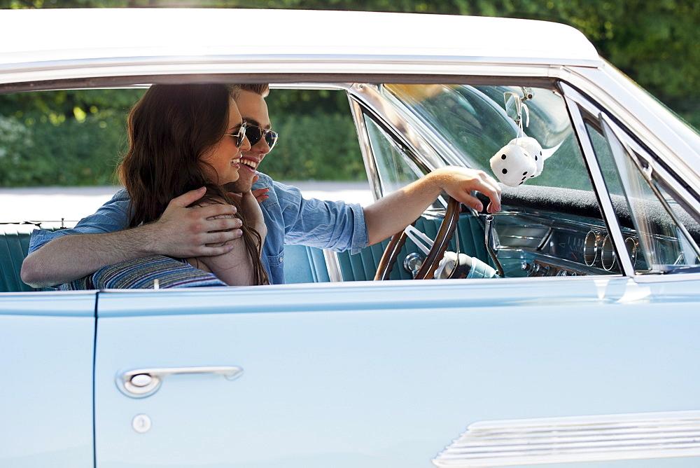 Couple in vintage car, Netherlands, Tilburg
