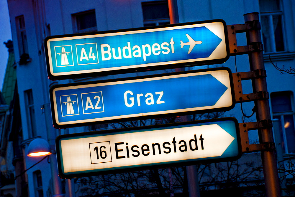View of road signs at dusk, Europe
