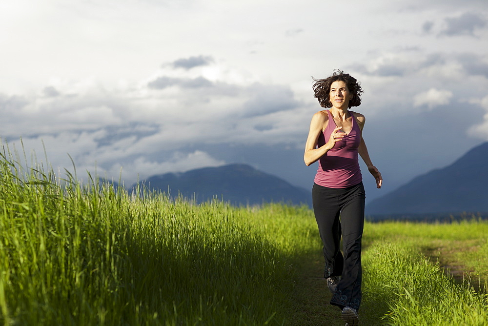 USA, Montana, Whitefish, Woman jogging on mountain path, USA, Montana, Whitefish