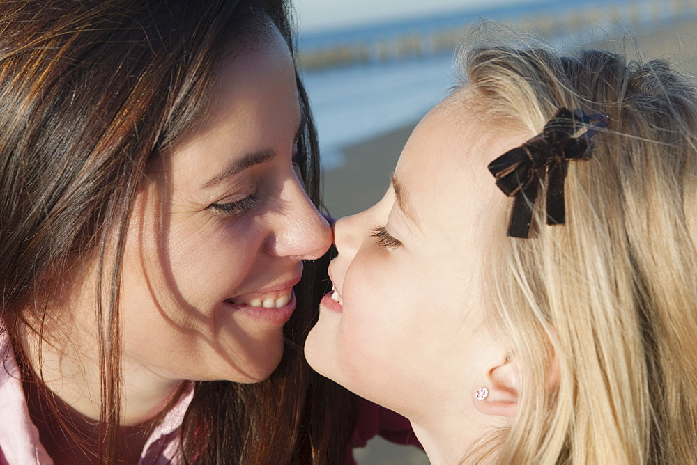 Mother with daughter exchanging eskimo kiss