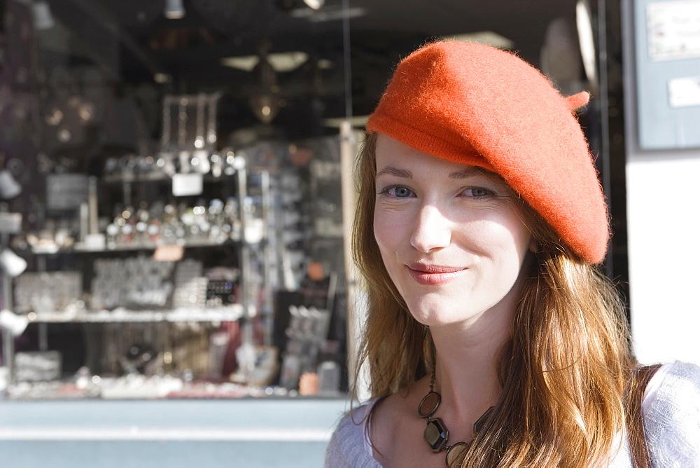 France, Pas-de-Calais, Escalles, Portrait of young woman in red beret, France, Pas-de-Calais, Escalles