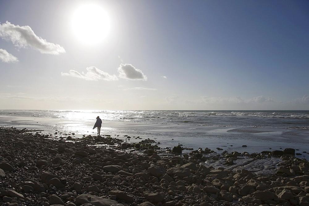 France, Pas-de-Calais, Escalles, Lonely walker on beach, France, Pas-de-Calais, Escalles