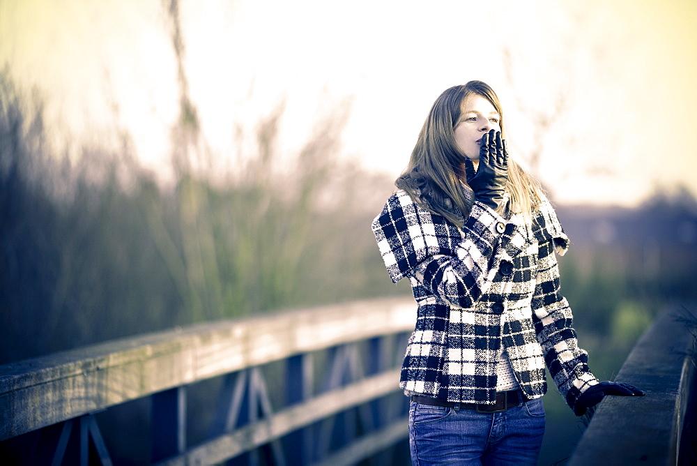 Young woman walking in winter sun