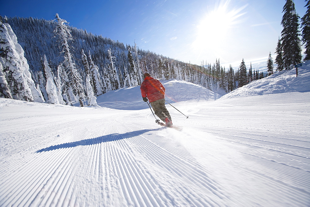 Man skiing in mountain scenery