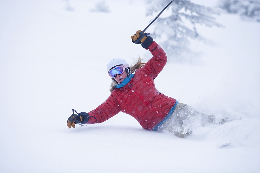 Woman skiing powder