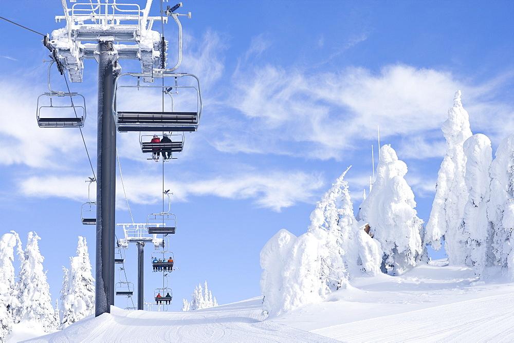 People using chair lift in ski resort