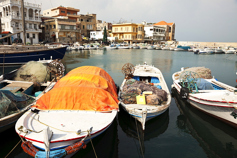 Small boats moored in local harbour