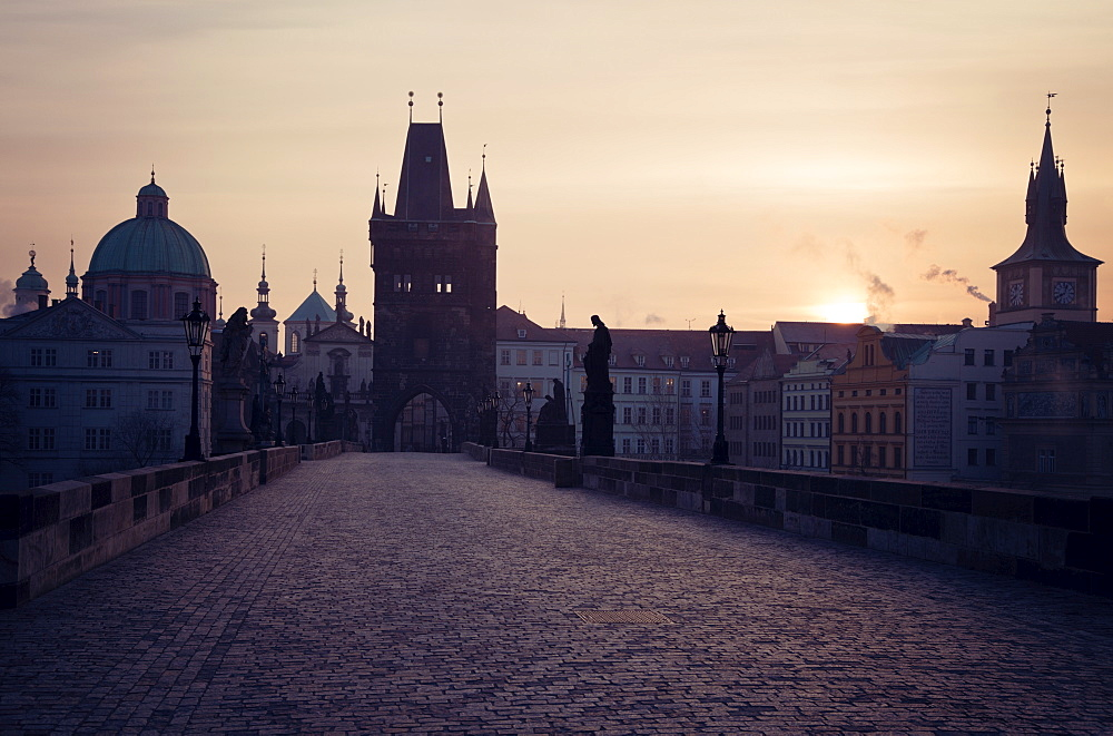 View over Charles Bridge towards Prague Castle in early morning