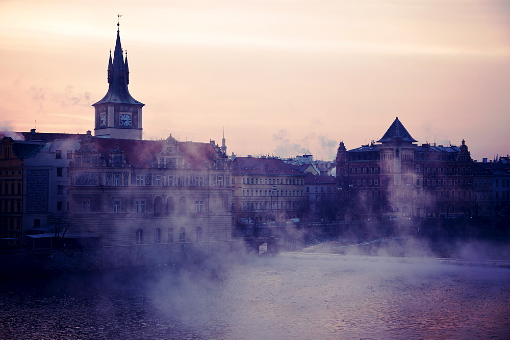 View over Vltava River towards Old Town at sunrise