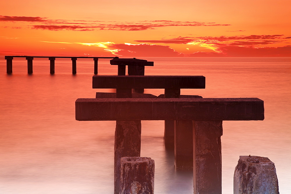 USA, Florida, Boca Grande, Ruined pier at sunset