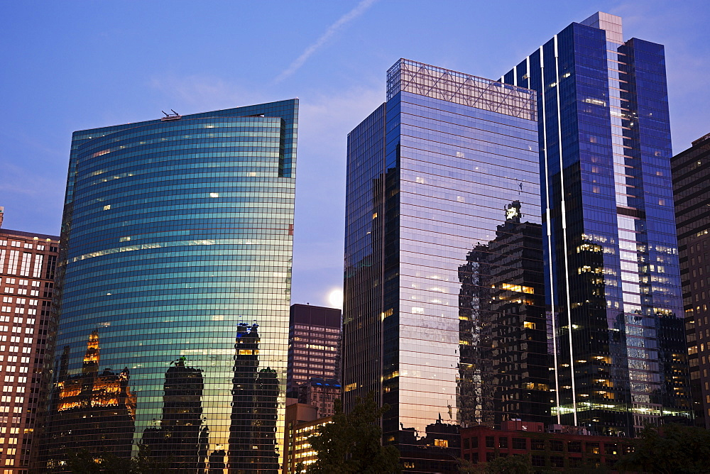 USA, Illinois, Chicago, Office buildings at dusk