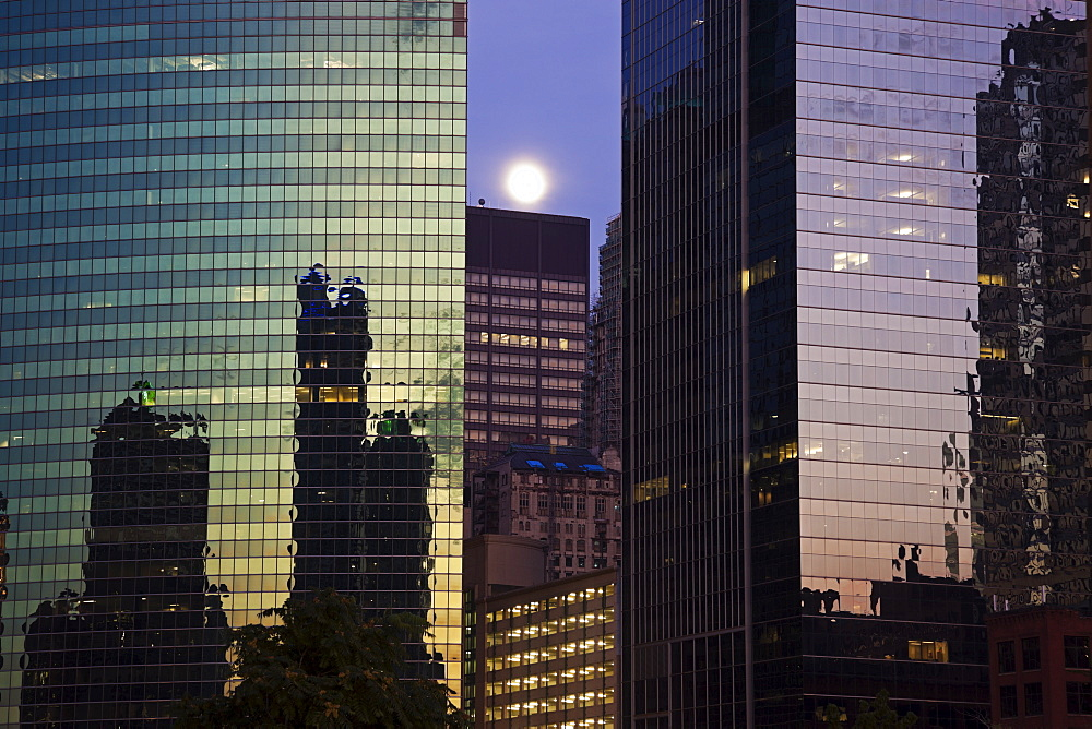 USA, Illinois, Chicago, Full moon over office buildings