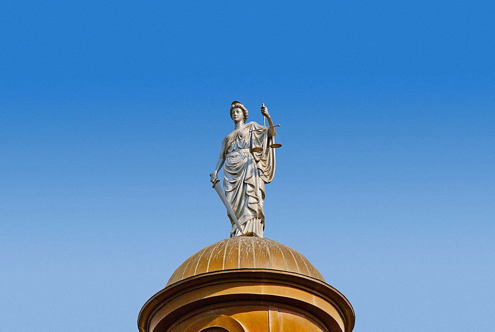 USA, Texas, San Marcos, Statue of Justice on top of copper dome of 1908 Hays County Courthouse